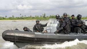 Members of Nigeria's navy aboard a small boat off Lagos, Nigeria - Friday 18 October 2013