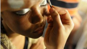 A model gets ready backstage during the Dominicana Moda Fashion Week 2013 in Santo Domingo, 24 October 2013