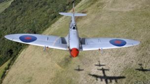 Spitfire flying over fields