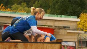 Competitors in an assault course