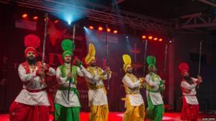 Men in colourful clothes celebrating Diwali. Photo: Alam Singh