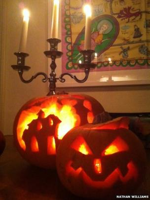 Two pumpkins carved by Nathan Williams