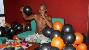 A man prepares balloons for Halloween (October 2013)