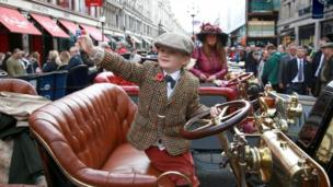 Henry Howe Davies, 5, sits on a 1902 Dion Bouton
