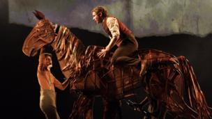 Jack Holden as Albert in War Horse, with Toby Olie, Thomas Wilton and Michael Brett as Joey
