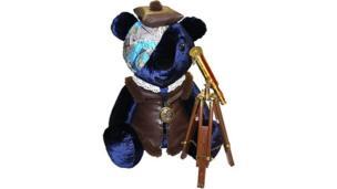 A blue bear with a telescope and atlas-styled bandana.
