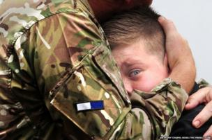 CO Colin Vaudin of 2 Signal Regiment embraces his son, Nicholas, 12, on his return from Afghanistan.