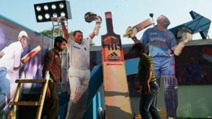 Indian workers adjust cut-outs of Sachin Tendulkar on a float made in honour of his second last Test against the West Indies in Calcutta, 3 November 2013