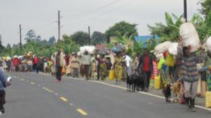 A picture taken by Ignatius Bahizi in which thousands of displaced people walk along the road from Bunagana to Kisoro town in Uganda on 4 November
