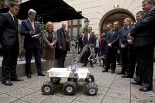 US Secretary of State John Kerry controls a Mars rover prototype