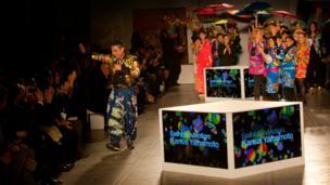 Kansai Yamamoto thanks the audience at his Fashion in Motion show at the V&A, London, 1 November 2013.