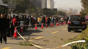 People stand after an explosion outside a provincial headquarters of China's ruling Communist Party in Taiyuan, Shanxi province, 6 November 2013