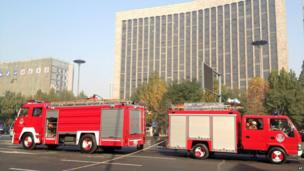 In this picture released by Xinhua, fire engines are seen at the site after explosions on the Yingze Street in Taiyuan, in Shanxi Province, 6 November 2013
