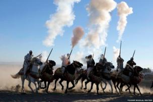 Horse riders perform with guns near the city of Fes