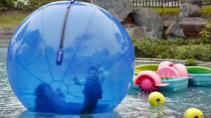 Plastic water ball floating in a pond in Lima's Park of the Exposition