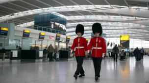 Soldiers at Heathrow Airport selling poppies ahead of Remembrance Sunday