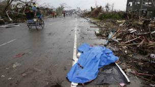 Body covered in plastic sheet in Tacloban. 10 Nov 2013