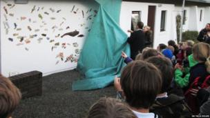 Unveiling of fish sculpture