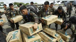 Personnel of the Philippines Army 51st engineer corps load water for victims of Typhoon Haiyan at Villamor Air Force Base in Manila, Philippines, on 11 November 2013