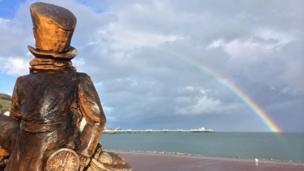Mad Hatter statue, Llandudno pier and rainbow