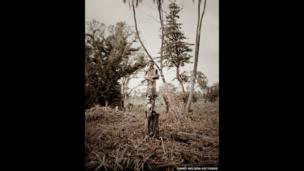 A Mursi tribesman holding a rifle
