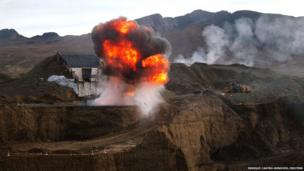 Peruvian police forces destroy machinery at an illegal gold mine