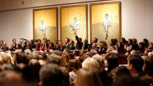 "Christie""s New York shows the bidding during the auction for the 1969 painting by Francis Bacon"