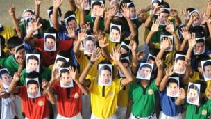 Students wear masks of Sachin Tendulkar in Nagpur, India, 13 November 2013