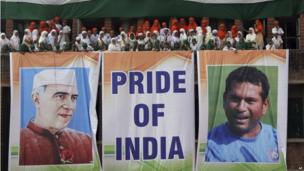 Students stand near giant banners showing Tendulkar and India's first prime minister Jawaharlal Nehru in the western city of Ahmedabad, 13 November 2013