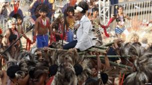 The Brazilian singer Margareth Menezes is carried by members of the indigenous Terena group during the Twelfth Games of the Indigenous People in Cuiaba