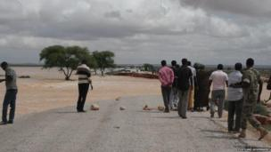 Puntland officials visit a bridge between Garowe and Eyl that was destroyed by the storm Somalia's semi-autonomous Puntland region near Bossasso