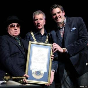 Morrison was presented with a scroll and a gold ceremonial key by Mr Ó Muilleoir and his mayoral predecessor Gavin Robinson.