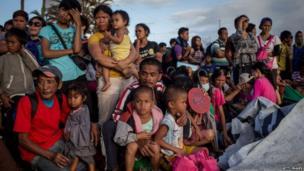People wait at Tacloban airport, 16 Nov