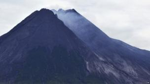 Mount Merapi spews volcanic material as it erupts as seen from Pakem, near the ancient city of Yogyakarta, Indonesia, early 18 November 2013