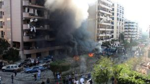 Flames rise from the site of a blast in Bir Hassan neighbourhood in southern Beirut, 19 Nov