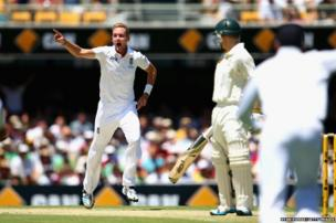 Stuart Broad of England celebrates after taking the wicket of Chris Rogers of Australia