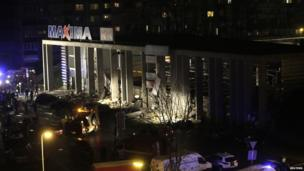 A general view shows a store with a collapsed roof in Riga