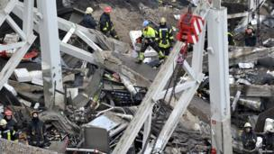 Rescue workers search debris of the Maxima supermarket in Riga, Latvia, Friday, Nov. 22, 2013