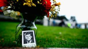 Flowers at a memorial in Dealey Plaza in Dallas