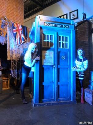Two people posing with the Tardis. Photo: Violet Ford