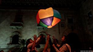 Women launch a paper hot air balloon