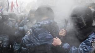 Police react to pepper spray in Kiev, Ukraine, 25 Nov