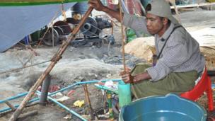 Worker extracting crude oil