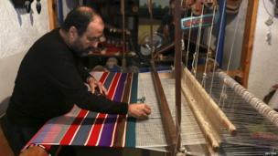 A man making a blanket on a loom in Tripoli, Libya - Thursday 28 November 2013