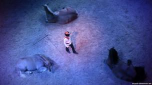 An actor performs during a dress rehearsal for the Christmas show of the Musee du Cheval