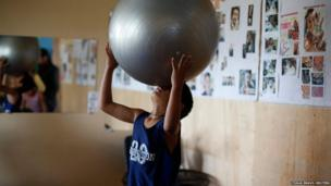 A child plays with a fitness ball at a gym in Tegucigalpa, Honduras
