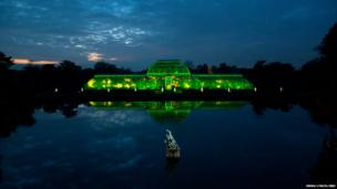 The Palm House is bathed in light at The Royal Botanic Gardens, Kew on November 27, 2013