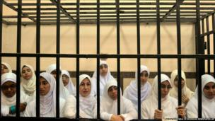 Egyptian women supporters of ousted President Mohammed Morsi in a courtroom in Alexandria, Egypt
