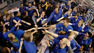Best Buy employees prepare to open the store