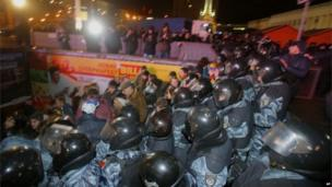 Police push protesters after dispersing them
